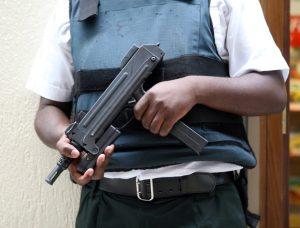 guard-with-machine-gun-1306461-300x228